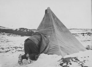 Dr Edward Wilson entering his tent at Cape Royds