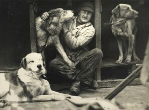 Dr Macklin with sledge dogs on board ship