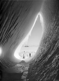 Grotto in an iceberg. Terra Nova in the distance. Taylor and Wright (Interior). January 5th 1911.