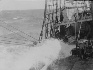 Heavy weather. Waves washing over the deck of the ship