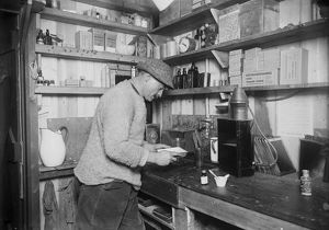 Herbert Ponting at work in darkroom. March 24th 1911