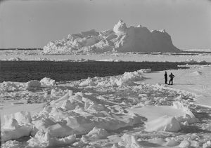 Iceberg in pack ice. Tryggve Gran and Thomas McLeod on ice. December 20th 1910