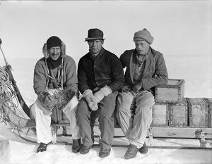 Lindsay, Scott and Stephenson, sitting on sledge, Ivigtut journey