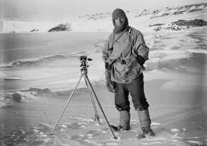 Lt Edgar Evans and one of the sledging theodolites, (Barne Glacier in the background). October 1911
