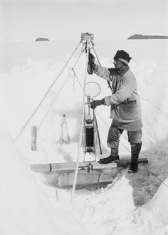 Nelson in his igloo with the Nansen-Petersson insulating water-bottle. December 24th 1911