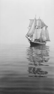 Penola at sea with sails set, reflections in the water