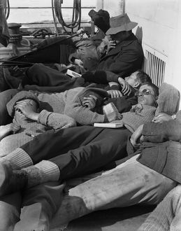 A warm day in the pack. Expedition members lie in the sun on the deck of the ship Terra Nova. December 28th 1910