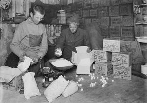 At Winterquarters Hut, packing sugar for sledging rations. January 1912