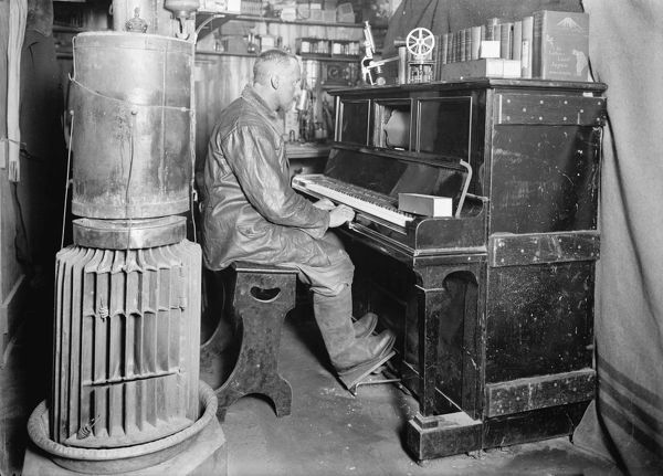 Cecil Meares at the pianola in the Winterquarters Hut. January 1912
