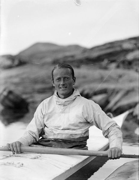Photographer: Cozens, Henry Iliffe (1904-1995). Expedition: British Arctic Air Route Expedition 1930-31. Leader: Henry George (Gino) Watkins. Date: 1930. Portrait of Watkins sitting in kayak