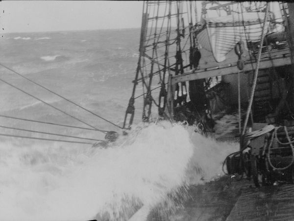 heavy weather waves washing deck ship